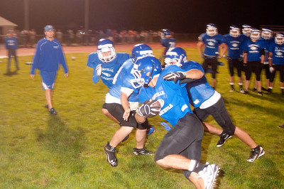 a player runs the ball during a 4 on 4 drill at midnight practice at PHS.