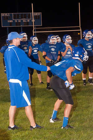 Coach Farrell holds a player back at the begining of a 4 on 4 drill during midnight practice.