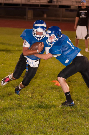 Players work on tackling during midnight practice at PHS