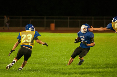 A player runs the ball to the outside during midnight practice at PHS.