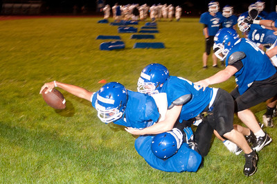 The running back reaches for the goal line during a 4 on 4 drill during midnight practice at PHS.