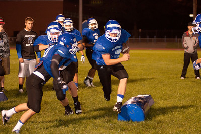 a player runs the ball during a dril at midnight practice at PHS