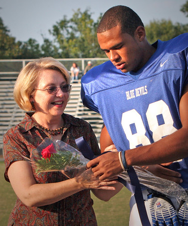 Sr AJ Mitchell gives mother Linda roses for Sr night