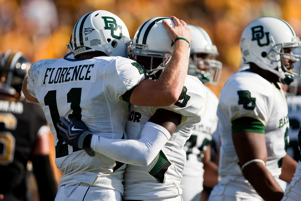 7 November 2009: Baylor quarterback Nick Florence (11) congratulates wide receiver Kendall Wright (1) after a touchdown during a game between the Missouri Tigers and the Baylor Bears at Memorial Stadium in Columbia, Missouri.