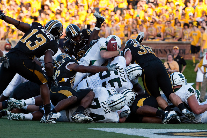 7 November 2009: Baylor quarterback Nick Florence (11) keeps the ball and is stopped just short of the goal line during the Baylor Bears 40-32 win over the Missouri Tigers at Memorial Stadium in Columbia, Missouri.