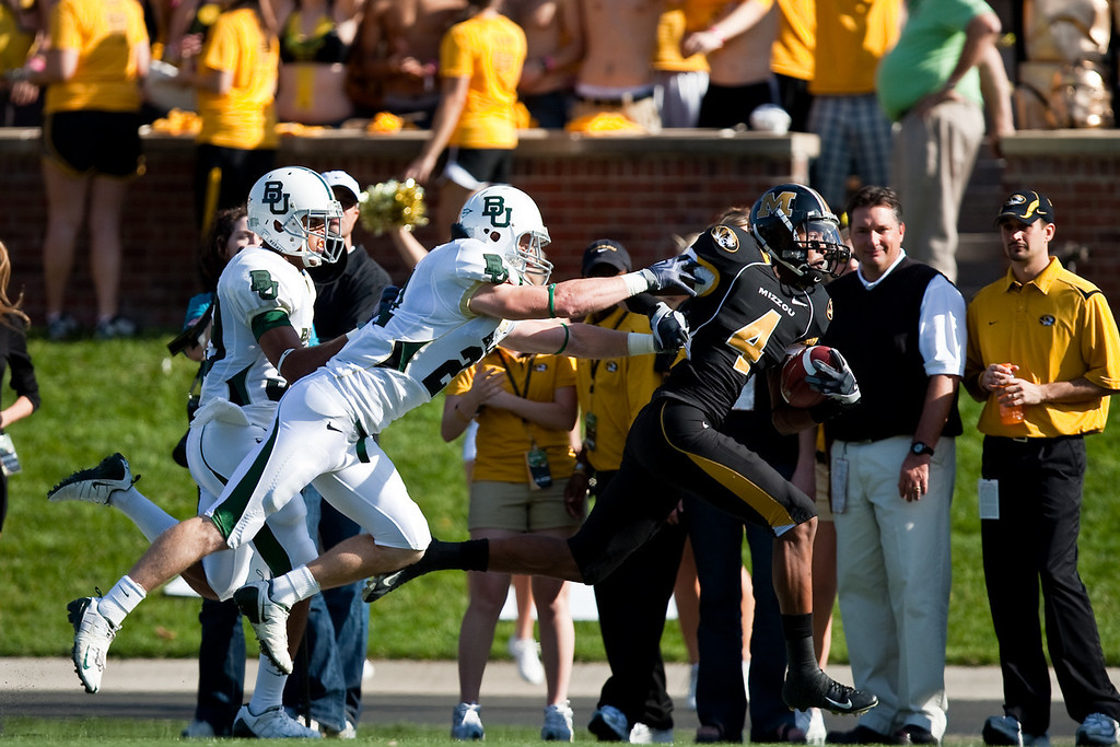 7 November 2009: Baylor safety Jordan Lake (21) pursues Missouri wide receiver Jared Perry (4) during the Baylor Bears 40-32 win over the Missouri Tigers at Memorial Stadium in Columbia, Missouri.