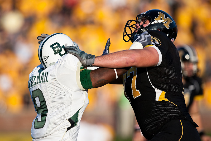 7 November 2009: Baylor defensive end Jameon Hardeman (9) battles with Missouri offensive lineman Dan Hoch (77) during the Baylor Bears 40-32 win over the Missouri Tigers at Memorial Stadium in Columbia, Missouri.