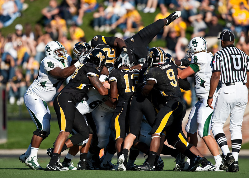 7 November 2009: Missouri's defense swarms Baylor during the Baylor Bears 40-32 win over the Missouri Tigers at Memorial Stadium in Columbia, Missouri.