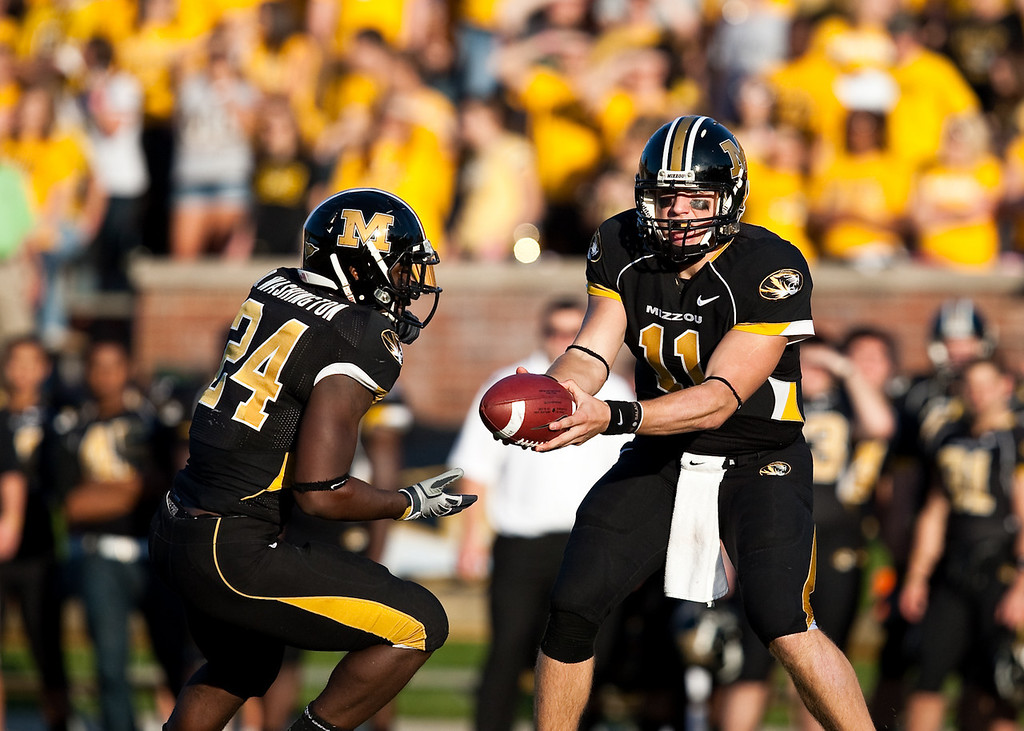 7 November 2009: Missouri quarterback Blaine Gabbert (11) hands the ball off to running back Derrick Washington (24) during the Baylor Bears 40-32 win over the Missouri Tigers at Memorial Stadium in Columbia, Missouri.