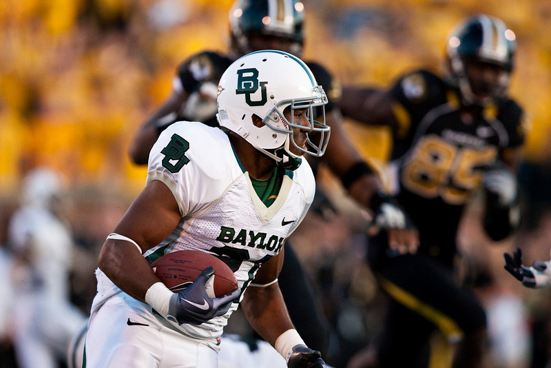 7 November 2009: Baylor running back Jarred Salubi (21) carries the ball during the Baylor Bears 40-32 win over the Missouri Tigers at Memorial Stadium in Columbia, Missouri.