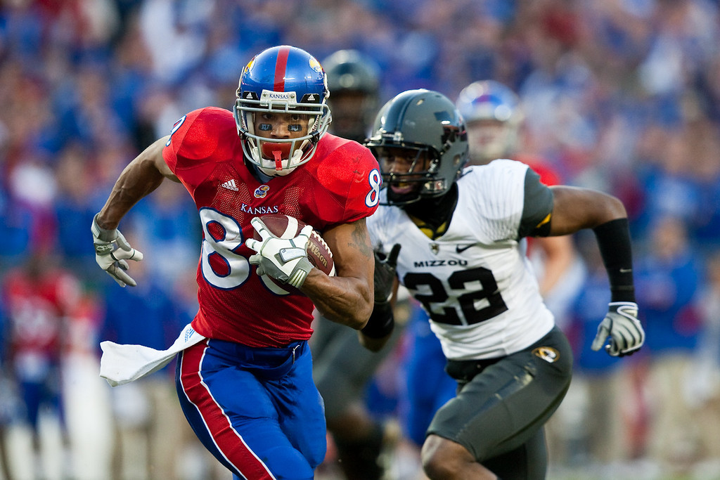 28 November 2009: Kansas wide receiver Dezmon Briscoe (80) outruns Missouri defensive back Robert Steeples (22) for a 33 yard pass reception during the Missouri Tigers 41-39 win over the Kansas Jayhawks at Arrowhead Stadium in Kansas City, Missouri.