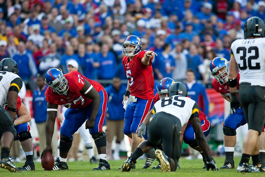 28 November 2009: Kansas offensive lineman Jeremiah Hatch (77) looks at the defense as quarterback Todd Reesing (5) directs his team during the Missouri Tigers 41-39 win over the Kansas Jayhawks at Arrowhead Stadium in Kansas City, Missouri.