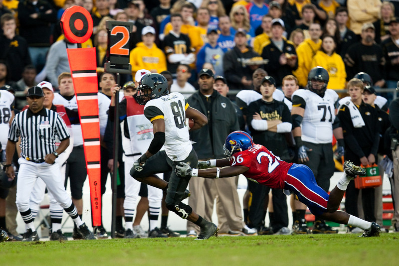 28 November 2009: Missouri wide receiver Danario Alexander (81) runs past Kansas safety Phillip Strozier (26) during the Missouri Tigers 41-39 win over the Kansas Jayhawks at Arrowhead Stadium in Kansas City, Missouri.