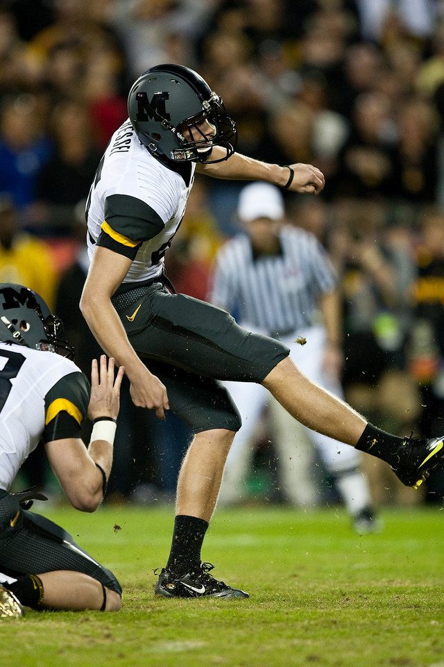 28 November 2009: Missouri kicker Grant Ressel (95) kicks a 27 yard game winning field goal during the Missouri Tigers 41-39 win over the Kansas Jayhawks at Arrowhead Stadium in Kansas City, Missouri.