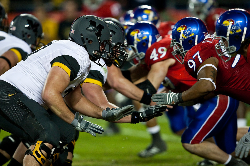 28 November 2009: The Missouri offensive line battles with the Kansas defensive line during the Missouri Tigers 41-39 win over the Kansas Jayhawks at Arrowhead Stadium in Kansas City, Missouri.