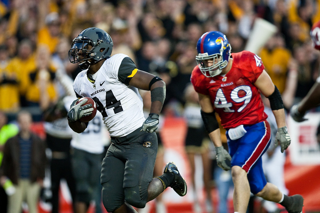 28 November 2009: Missouri running back Derrick Washington (24) outruns Kansas linebacker Drew Dudley (49) for a 14 yard touchdown during the Missouri Tigers 41-39 win over the Kansas Jayhawks at Arrowhead Stadium in Kansas City, Missouri.