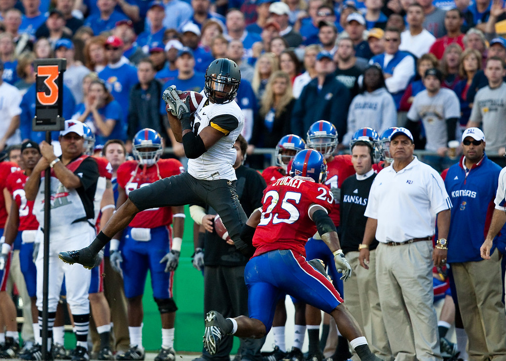 28 November 2009: Missouri wide receiver Danario Alexander (81) hauls in a pass in front of Kansas safety Darrell Stuckey (25) during the Missouri Tigers 41-39 win over the Kansas Jayhawks at Arrowhead Stadium in Kansas City, Missouri.