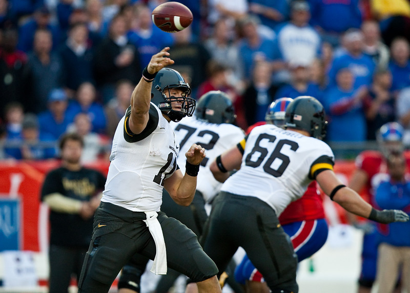 28 November 2009: Missouri quarterback Blaine Gabbert (11) passes the ball during the Missouri Tigers 41-39 win over the Kansas Jayhawks at Arrowhead Stadium in Kansas City, Missouri.