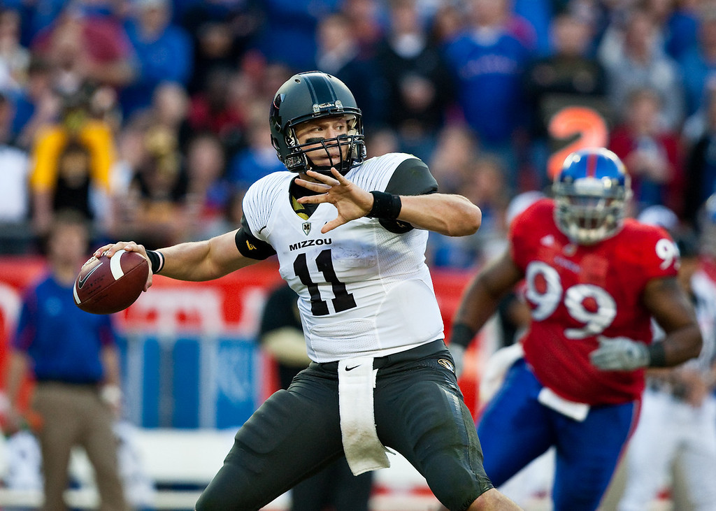 28 November 2009: Missouri quarterback Blaine Gabbert (11) throws the ball during the Missouri Tigers 41-39 win over the Kansas Jayhawks at Arrowhead Stadium in Kansas City, Missouri.