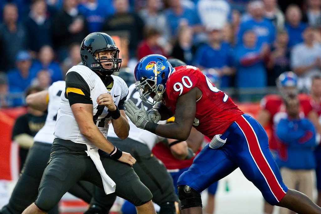 28 November 2009: Missouri quarterback Blaine Gabbert (11) braces for a hit by Kansas defensive end Maxwell Onyegbule (90) during the Missouri Tigers 41-39 win over the Kansas Jayhawks at Arrowhead Stadium in Kansas City, Missouri.