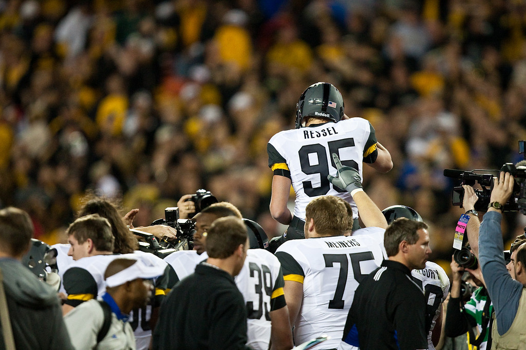 28 November 2009: Missouri kicker Grant Ressel (95) is lifted onto his teammates shoulders after kicking a 27 yard game winning fieldgoal during the Missouri Tigers 41-39 win over the Kansas Jayhawks at Arrowhead Stadium in Kansas City, Missouri.