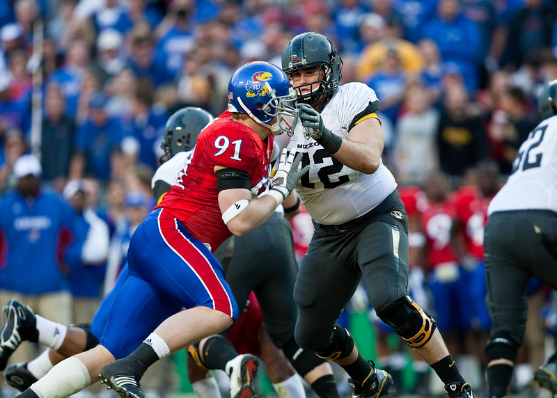 28 November 2009: Missouri offensive lineman Elvis Fisher (72) battles with Kansas defensive end Jake Laptad (91) during the Missouri Tigers 41-39 win over the Kansas Jayhawks at Arrowhead Stadium in Kansas City, Missouri.
