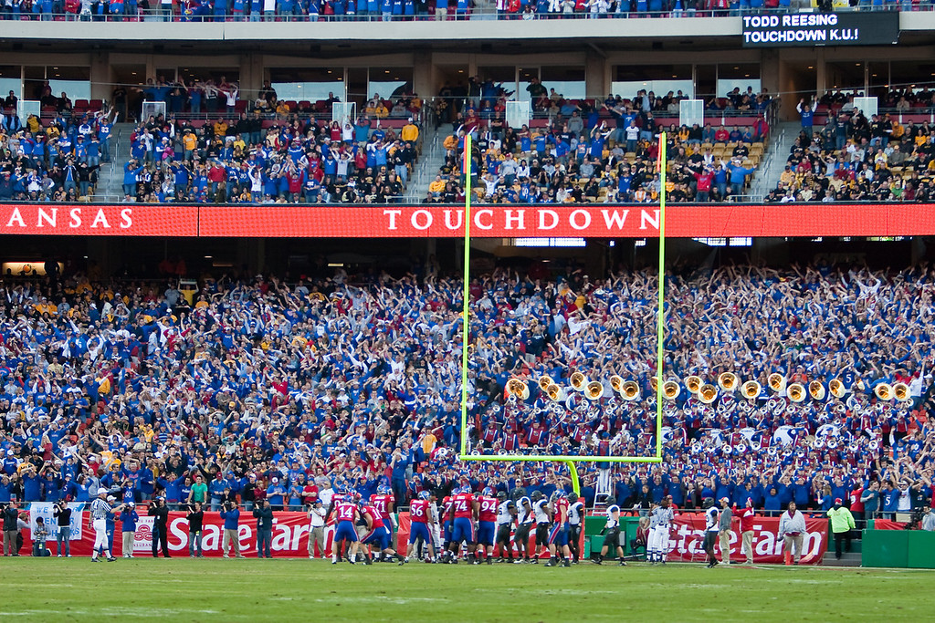 28 November 2009: The Kansas fans wave their arms after a Todd Reesing 1 yard touchdown run during the Missouri Tigers 41-39 win over the Kansas Jayhawks at Arrowhead Stadium in Kansas City, Missouri.