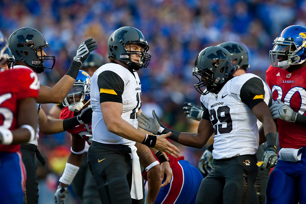 28 November 2009: Missouri quarterback Blaine Gabbert (11) is congratulated by wide receiver Jerrell Jackson (29) after Gabbert rushed for a first down during the Missouri Tigers 41-39 win over the Kansas Jayhawks at Arrowhead Stadium in Kansas City, Missouri.