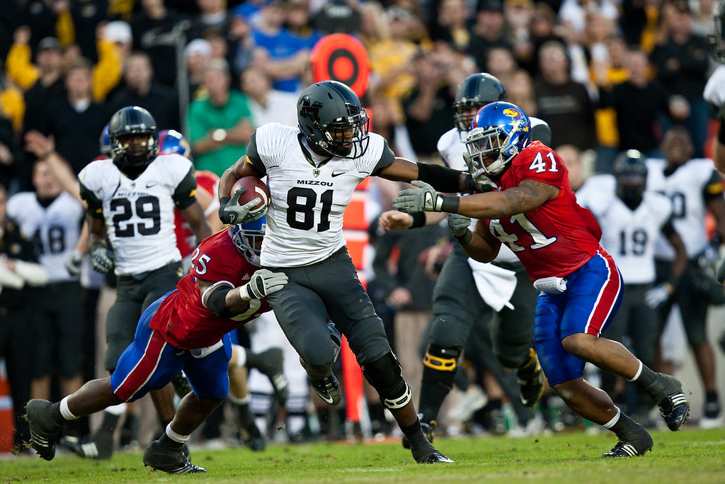 28 November 2009: Missouri wide receiver Danario Alexander (81) pushes off Kansas linebacker Arist Wright (41) for a 29 yard pass reception during the Missouri Tigers 41-39 win over the Kansas Jayhawks at Arrowhead Stadium in Kansas City, Missouri.
