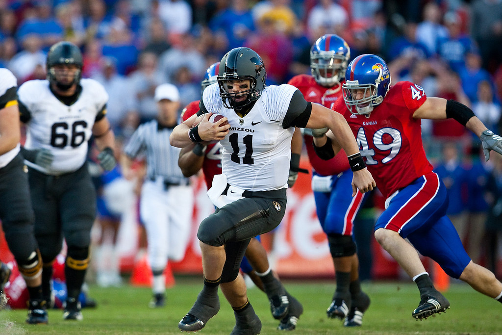 28 November 2009: Missouri quarterback Blaine Gabbert (11) runs with the ball during the Missouri Tigers 41-39 win over the Kansas Jayhawks at Arrowhead Stadium in Kansas City, Missouri.