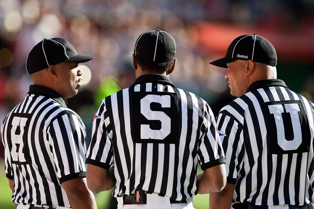 28 November 2009: Several officials talk before the Missouri Tigers 41-39 win over the Kansas Jayhawks at Arrowhead Stadium in Kansas City, Missouri.