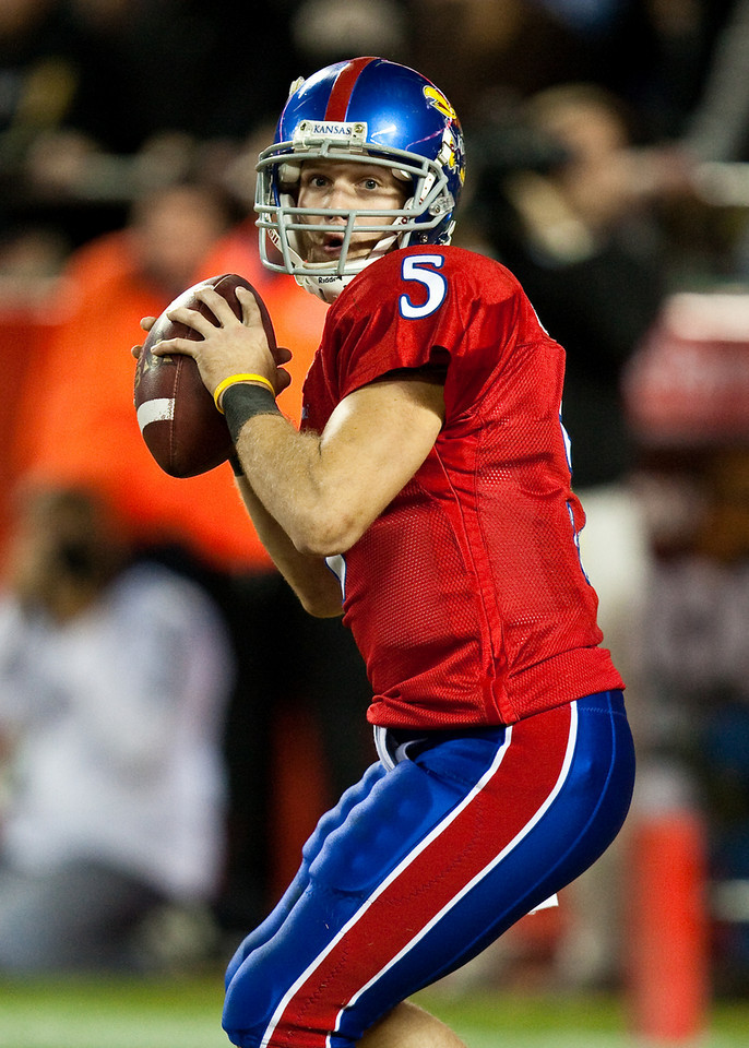 28 November 2009: Kansas quarterback Todd Reesing (5) looks for an open receiver during the Missouri Tigers 41-39 win over the Kansas Jayhawks at Arrowhead Stadium in Kansas City, Missouri.