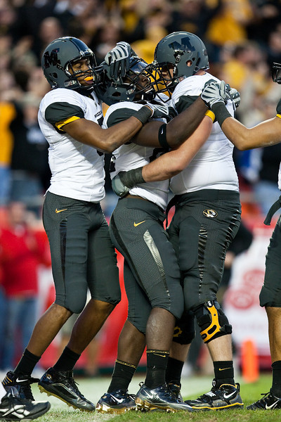 28 November 2009: Missouri wide receiver Rolandis Woodland (left) and offensive lineman Elvis Fisher (right) congratulate running back Derrick Washington (center) after his 14 yard touchdown run during the Missouri Tigers 41-39 win over the Kansas Jayhawks at Arrowhead Stadium in Kansas City, Missouri.