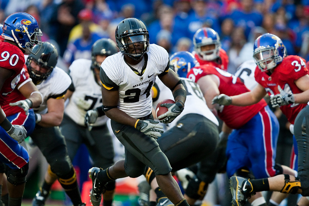 28 November 2009: Missouri running back Derrick Washington (24) walks into the end zone for a 1 yard touchdown during the Missouri Tigers 41-39 win over the Kansas Jayhawks at Arrowhead Stadium in Kansas City, Missouri.