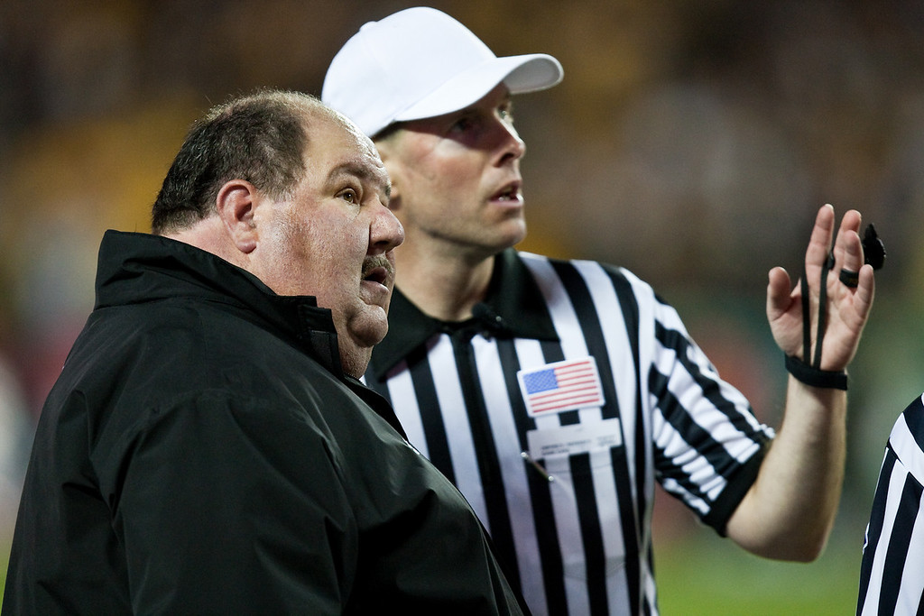 28 November 2009: Kansas head coach Mark Mangino looks at the replay with referee Scott Novak during the Missouri Tigers 41-39 win over the Kansas Jayhawks at Arrowhead Stadium in Kansas City, Missouri.