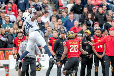 PSU's Juwan Johnson hauls in a first quarter pass in front of the Maryland bench