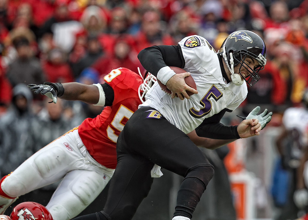 January 9, 2011: Baltimore Ravens quarterback Joe Flacco (5) tries to get past Kansas City Chiefs linebacker Jovan Belcher (59) during an AFC Wild Card game where the Baltimore Ravens defeated the Kansas City Chiefs 30-7 at Arrowhead Stadium in Kansas City, Missouri.