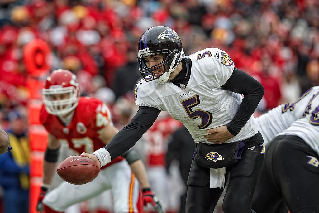 January 9, 2011: Baltimore Ravens quarterback Joe Flacco (5) hands off the ball during an AFC Wild Card game where the Baltimore Ravens defeated the Kansas City Chiefs 30-7 at Arrowhead Stadium in Kansas City, Missouri.