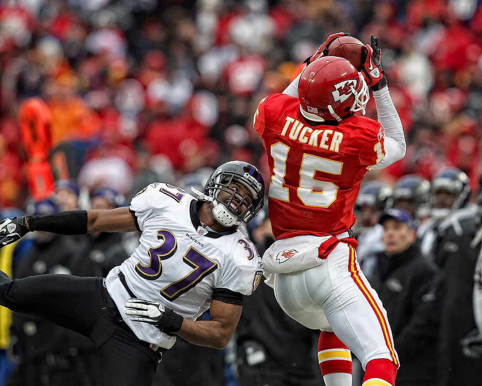 January 9, 2011: Kansas City Chiefs wide receiver Verran Tucker (15) makes catch that was ruled out of bounds while Baltimore Ravens cornerback Josh Wilson (37) defends during an AFC Wild Card game where the Baltimore Ravens defeated the Kansas City Chiefs 30-7 at Arrowhead Stadium in Kansas City, Missouri.