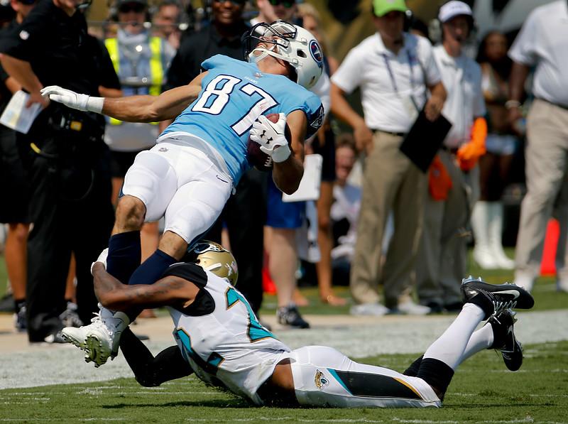 APTOPIX Titans Jaguars Football