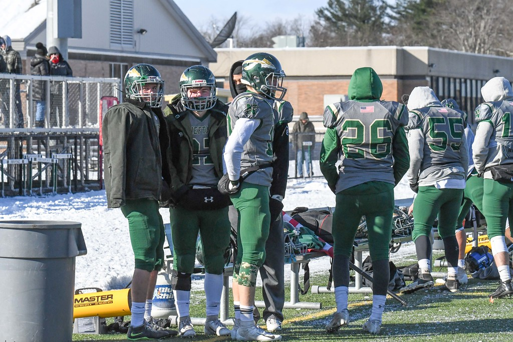 . Nashoba players warm up with a heater on the sidelines between plays. Sentinel & Enterprise/Ed Niser