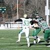 Nashoba senior quarterback Sam Bolinsky fires a pass under pressure. Sentinel & Enterprise/ Ed Niser