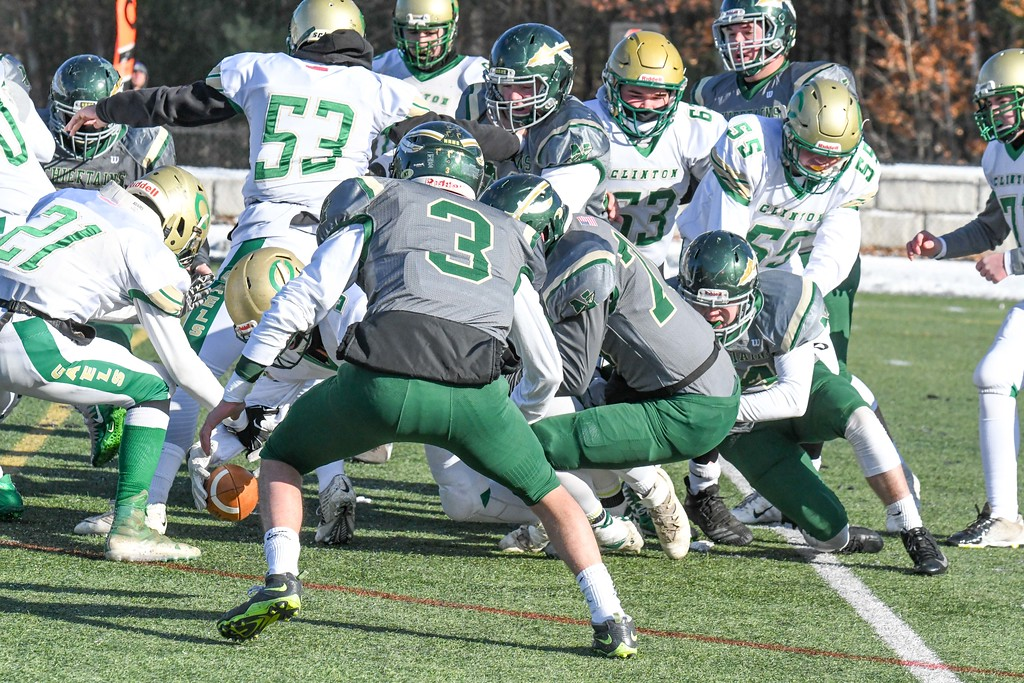 . The Nashoba defense jars the ball loose from the hands of Clinton\'s Patrick Flaherty in the first half. Nashoba won the contest, 21-0, in Bolton on Thanksgiving Day, Thursday, Nov. 22, 2018. Sentinel & Enterprise/Ed Niser