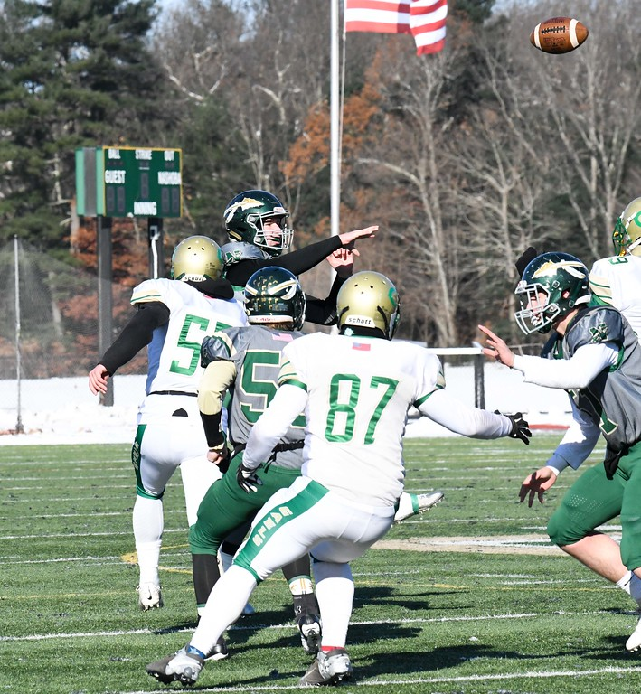 . Nashoba senior quarterback Sam Bolinsky fires a pass under pressure. Sentinel & Enterprise/ Ed Niser