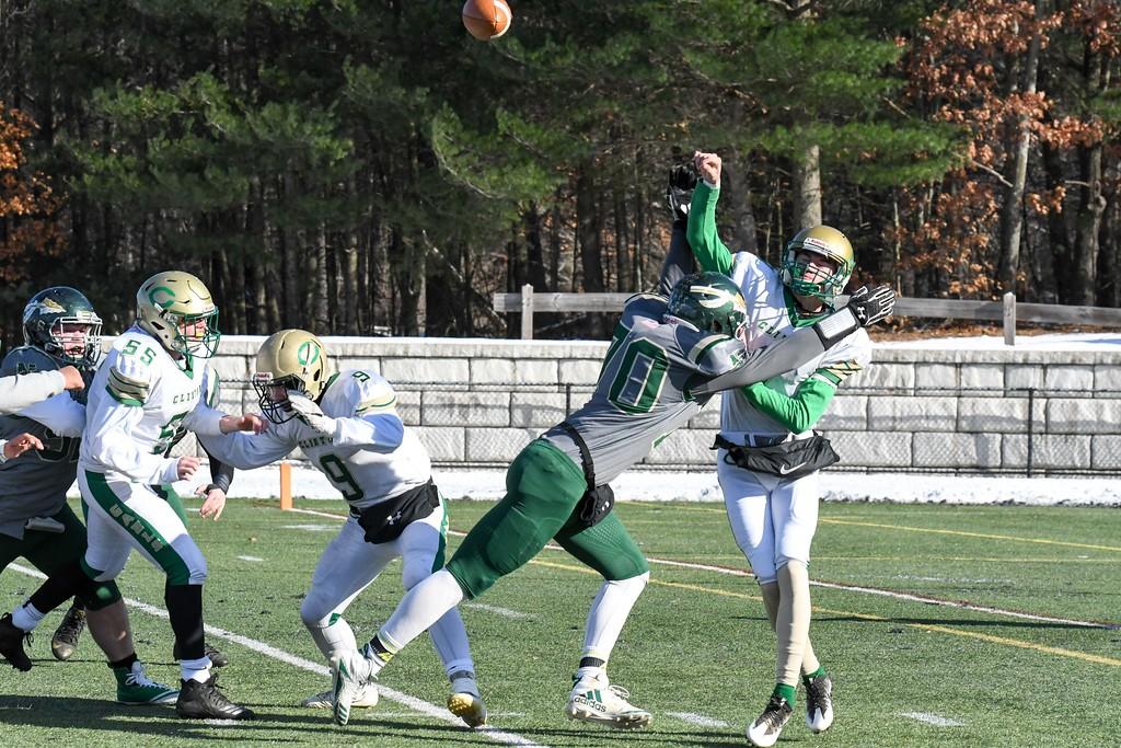 . Nashoba senior defensive lineman Eli Bachtell hits Clinton quarterback Will Jent as he releases a pass. Sentinel & Enterprise/Ed Niser