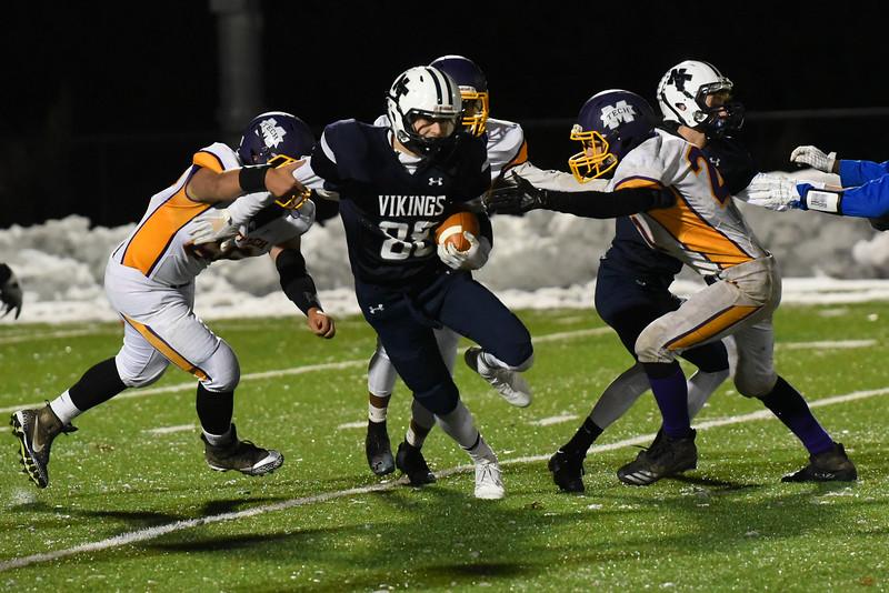 112118 WESTFORD-  Vikings junior Tyler Alden (center) is tackled by Monty Tech defenders in Wednesday night's game at Nashoba Tech.  SENTINEL & ENTERPRISE JEFF PORTER