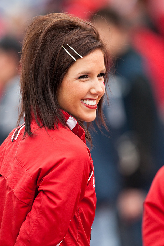 14 November 2009: A Nebraska cheerleader entertains the crowd during the Nebraska Cornhuskers 31-17 win over the Kansas Jayhawks at Memorial Stadium in Lawrence, Kansas.