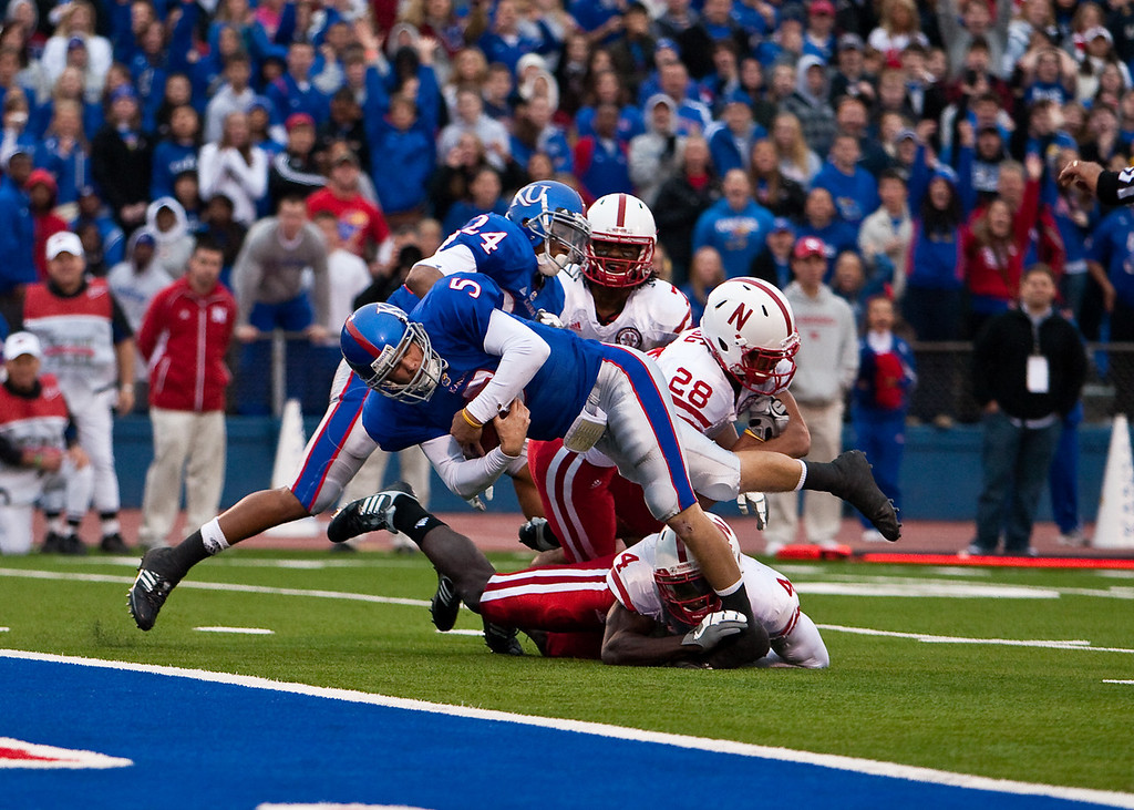 14 November 2009: Kansas quarterback Todd Reesing (5) escapes the grasp of Nebraska safety Larry Asante (4) and runs 5 yards for a touchdown during the Nebraska Cornhuskers 31-17 win over the Kansas Jayhawks at Memorial Stadium in Lawrence, Kansas.