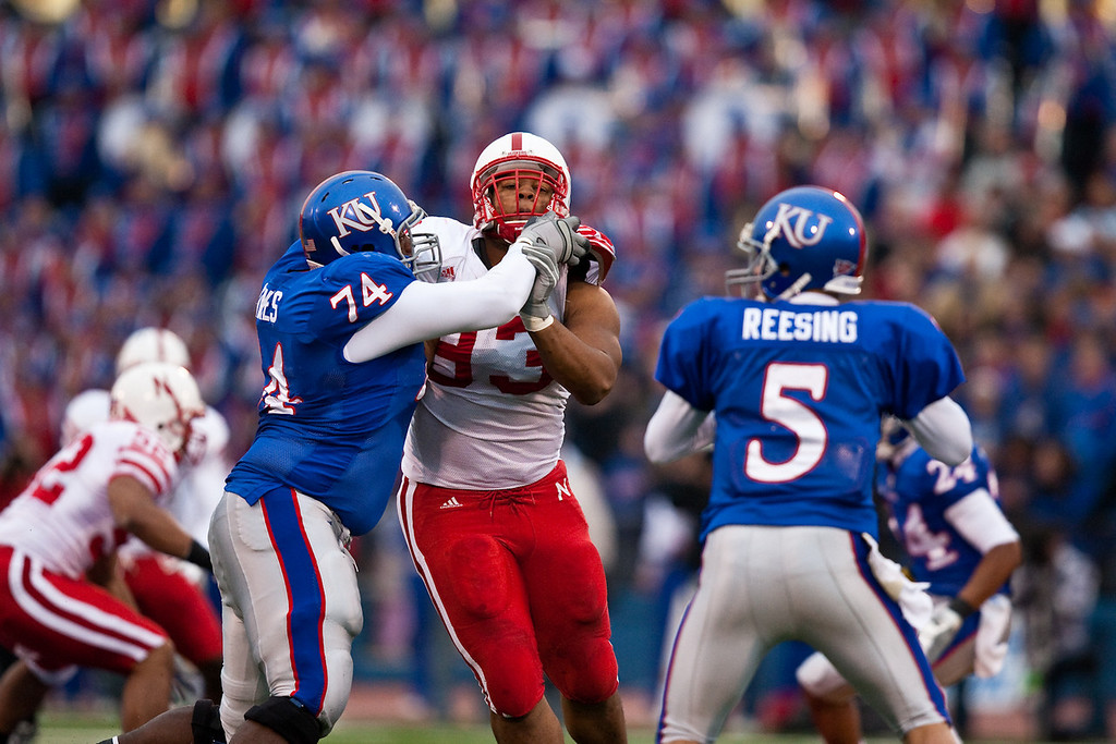 14 November 2009: Nebraska defensive tackle Ndamukong Suh (93) battles with Kansas offensive lineman Jeff Spikes (74) during the Nebraska Cornhuskers 31-17 win over the Kansas Jayhawks at Memorial Stadium in Lawrence, Kansas.