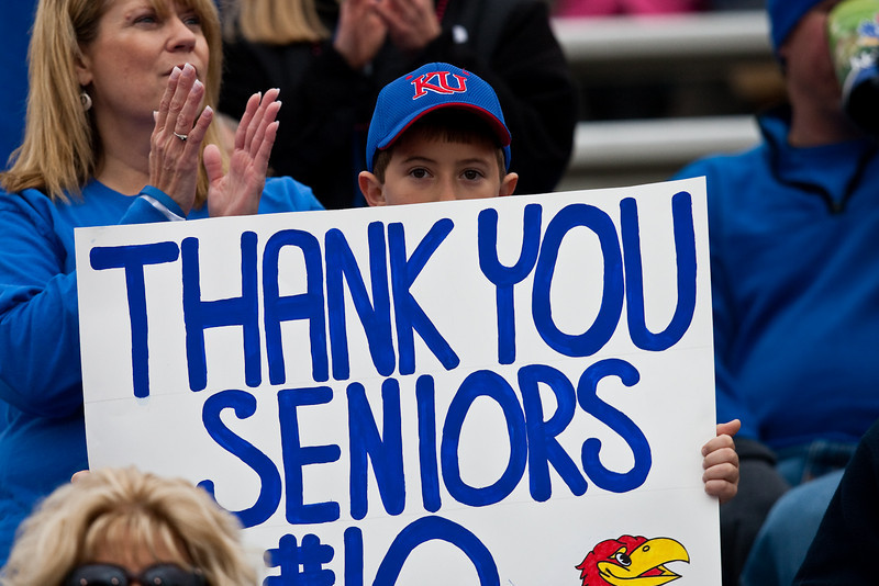 14 November 2009: A young Kansas fan holds up a sign thanking the seniors during the Nebraska Cornhuskers 31-17 win over the Kansas Jayhawks at Memorial Stadium in Lawrence, Kansas.